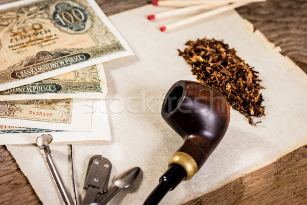 Pipe, old paper and old money Stock photo © superelaks