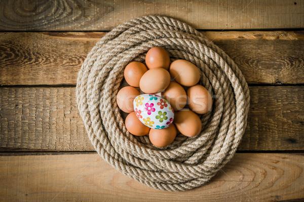 Paskalya yumurtası sepet halat ahşap masa Paskalya doğa Stok fotoğraf © superelaks