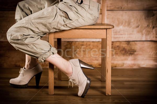 Girl sitting sideways on a chair Stock photo © superelaks