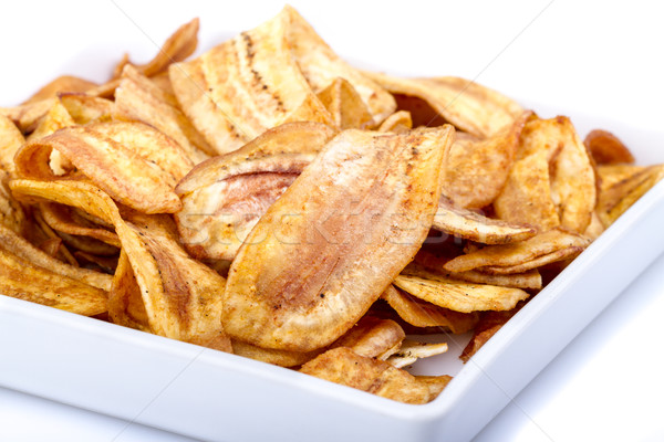 Stock photo: Crispy banana chip on white dish