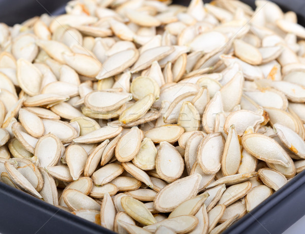 Pumkin seeds on black dish Stock photo © supersaiyan3