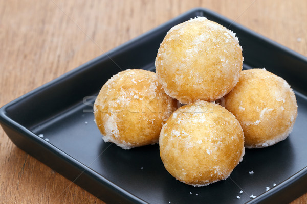 Crisp sweet rice ball on black plate Stock photo © supersaiyan3