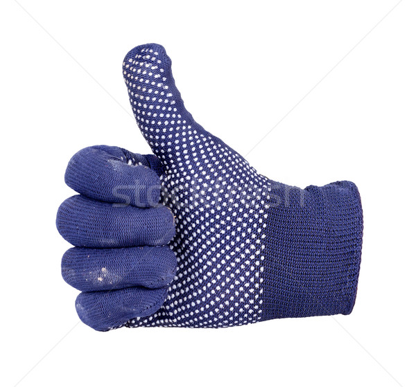 Thumb up showing by hand with blue and white dot knitting wool g Stock photo © supersaiyan3