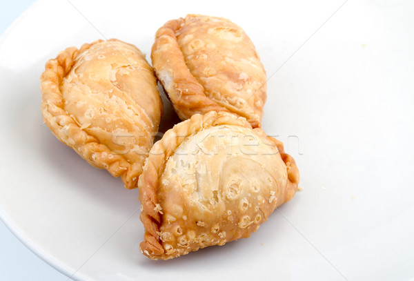 fried Curry Puffs on white dish Stock photo © supersaiyan3