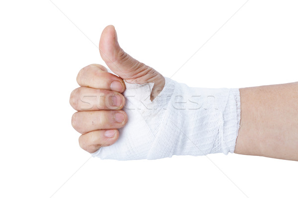 Thumb up showing by hand with white bandages isolated on white Stock photo © supersaiyan3