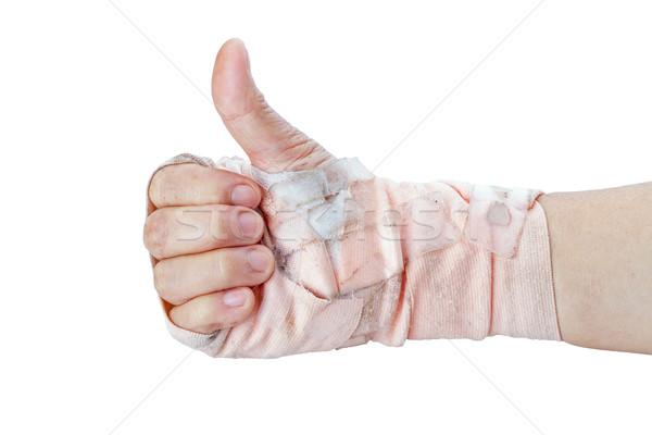 Thumb up showing by hand with bandages isolated on white Stock photo © supersaiyan3