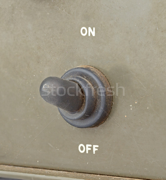 old black toggle switch on green surface - on Stock photo © supersaiyan3