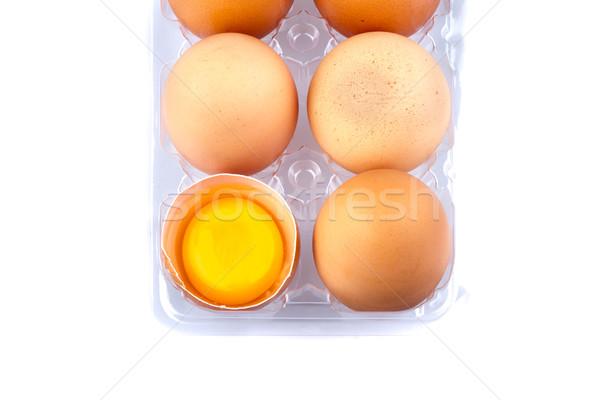Huevos yema de huevo plástico transparente paquete blanco Foto stock © supersaiyan3