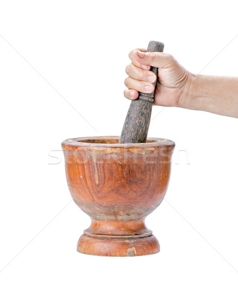 Mortar and pestle on isolated white background with hand Stock photo © supersaiyan3