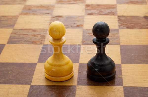 Pawns on a chessboard Stock photo © Supertrooper