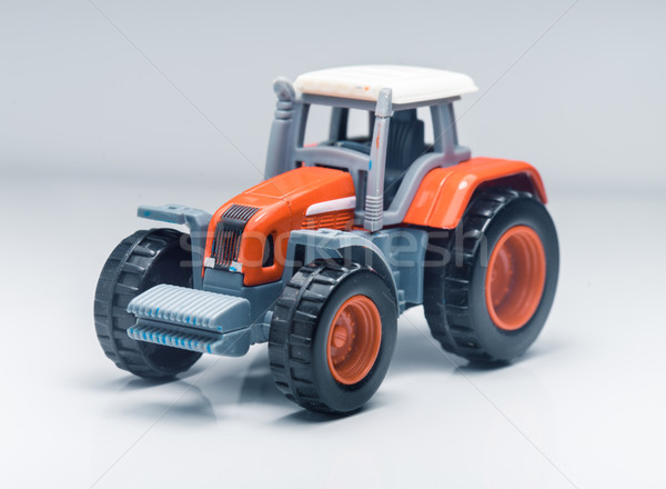 Children plastic toy tractor Stock photo © Supertrooper
