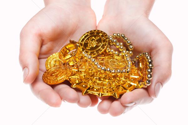 Hand holding treasures Stock photo © Supertrooper