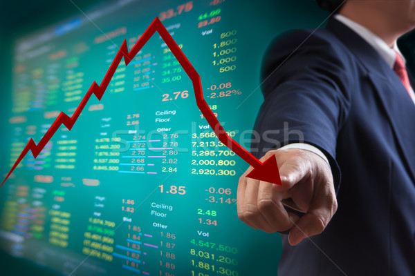 Business man point to falling graph of stock market Stock photo © Suriyaphoto