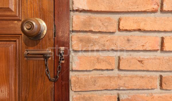 Ahşap kapı kilitli dolap kırmızı tuğla ahşap Stok fotoğraf © Suriyaphoto