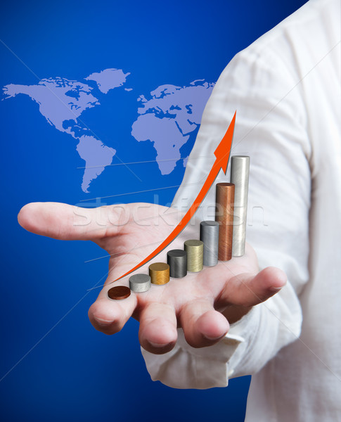 Business man holding growth graph with world map background Stock photo © Suriyaphoto