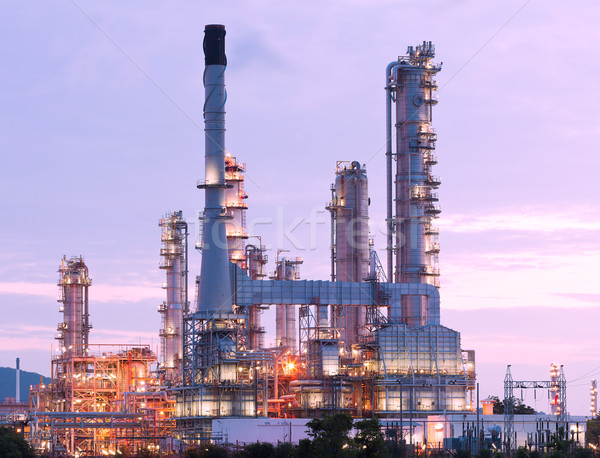 Stock photo: scenic of petrochemical oil refinery plant shines at night, clos