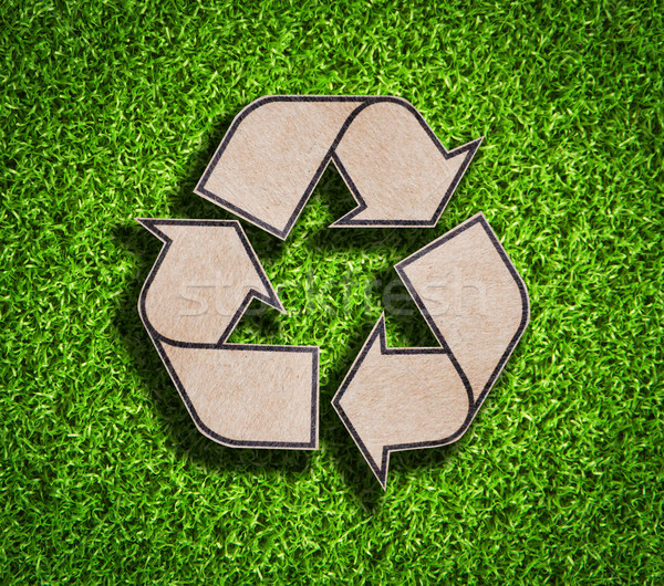 Recycle sign on green grass background Stock photo © Suriyaphoto