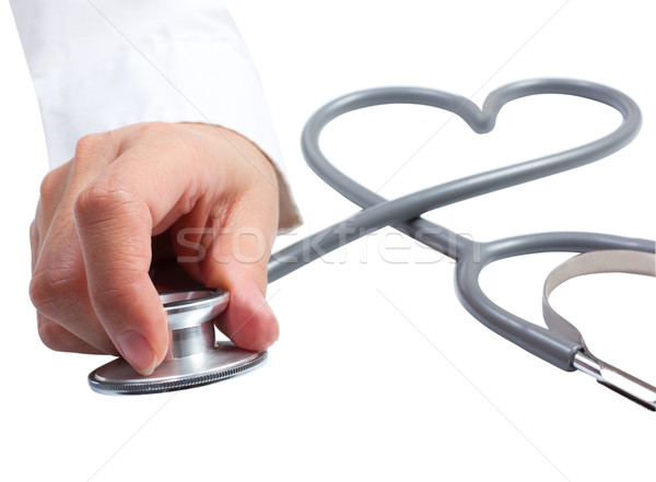 Female hand holding stethoscope; health care concept Stock photo © Suriyaphoto