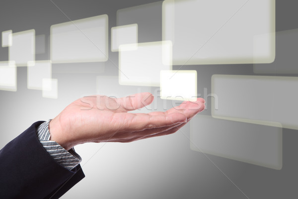 Business hand pushing on a touch screen interface Stock photo © Suriyaphoto
