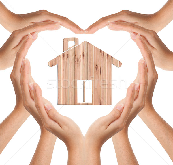 Hands make heart shape with wood house Stock photo © Suriyaphoto