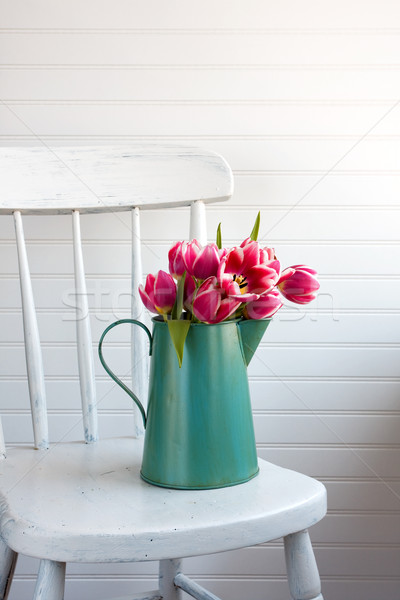 Tulip flowers on chair Stock photo © susabell