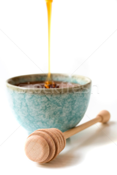 Honey with drizzle stick  Stock photo © susabell