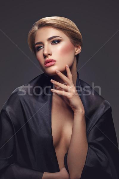 Beautiful girl with cat eye make-up Stock photo © svetography