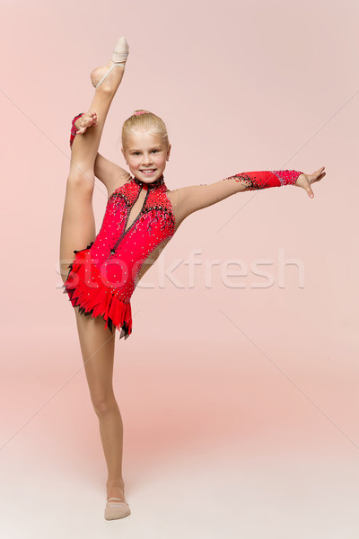 Beautiful girl gymnast training twine Stock photo © svetography