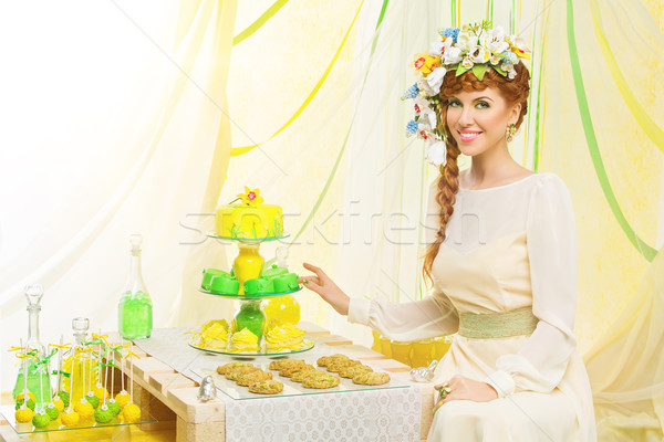 Beautiful girl with cupcakes Stock photo © svetography