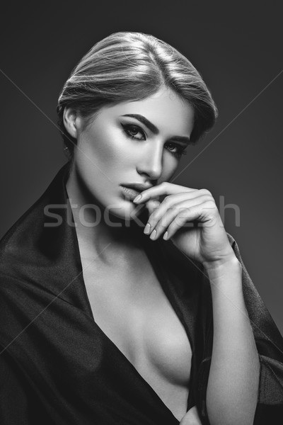 Beautiful girl with cat eye make-up Stock photo © svetography