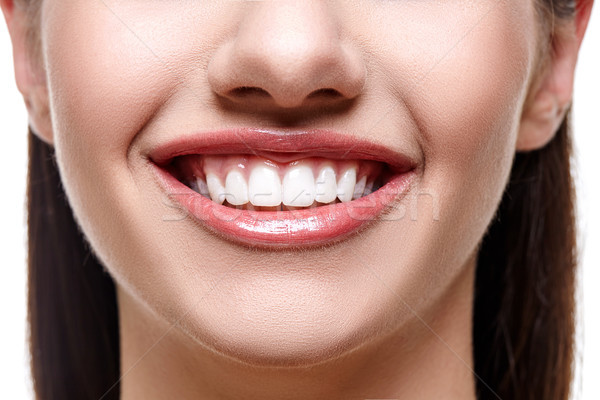 smiling woman with white teeth Stock photo © svetography