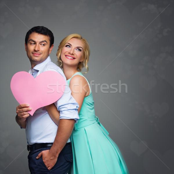 Beautiful couple holding pink heart Stock photo © svetography