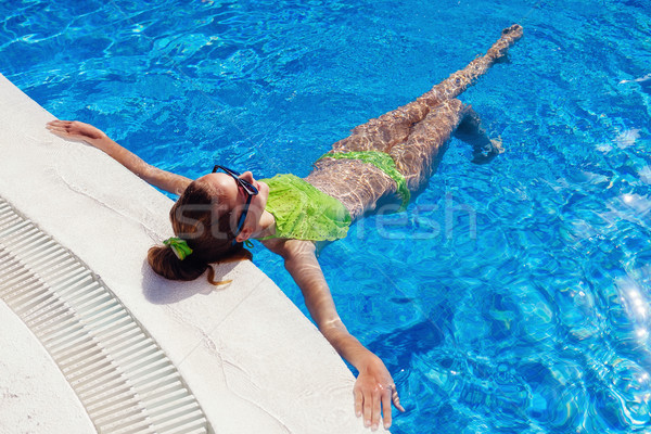 teen girl relaxing near swimming pool Stock photo © svetography