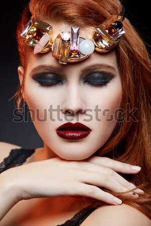 beautiful girl with modern braids and metal flower in mouth Stock photo © svetography
