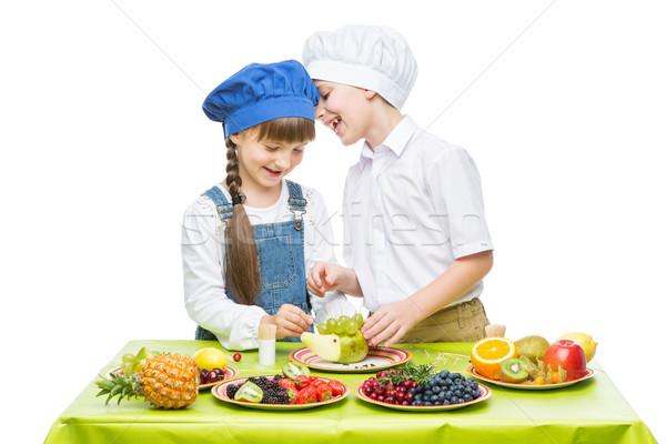 Enfants fruits collations peu garçon Photo stock © svetography
