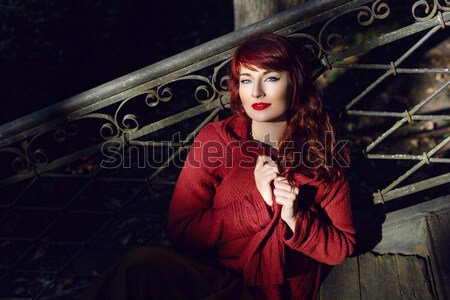 Beautiful girl with smoky eyes and red lips holding cigarette Stock photo © svetography