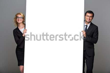 Businessman and business woman with big empty poster Stock photo © svetography