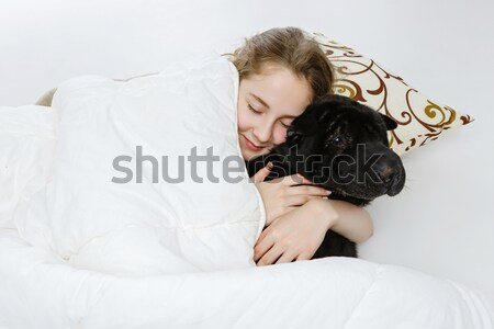 подростка девушка спальный собака кровать черный Сток-фото © svetography