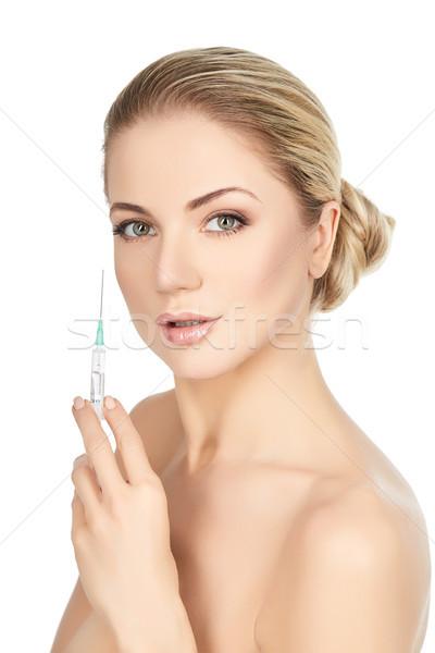 beautiful girl holding syringe isolated on white Stock photo © svetography