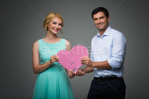 Beautiful couple holding pink broken heart Stock photo © svetography