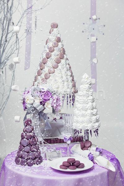 Big New Year's or wedding cake on lightly decorated background. Stock photo © svetography