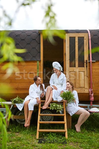 Három lányok megnyugtató kívül szauna gyönyörű Stock fotó © svetography