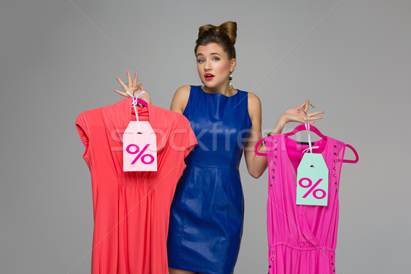 Confused girl with dresses Stock photo © svetography