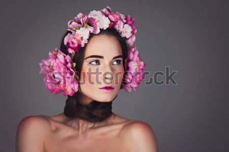 Beautiful girl with purple makeup and head piece Stock photo © svetography