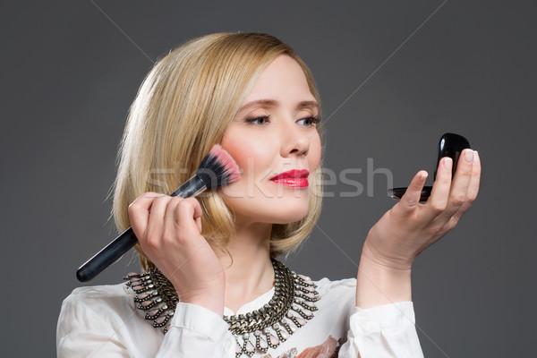 Gyönyörű középkorú nő jelentkezik bőrpír középkorú szőke Stock fotó © svetography