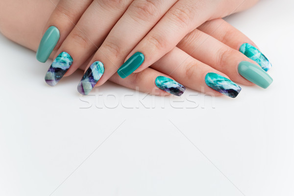 Closeup of woman hands with colorful nails Stock photo © svetography