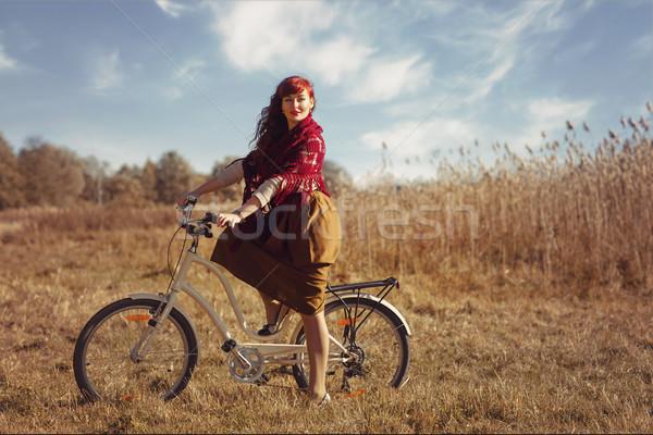 Güzel kız binicilik bisiklet alan güzel Stok fotoğraf © svetography