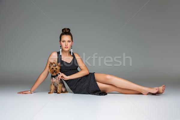 Girl with yorkie dog Stock photo © svetography