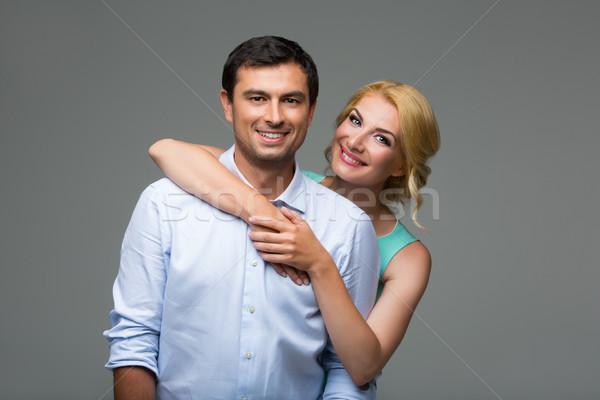 Beautiful happy couple hugging Stock photo © svetography