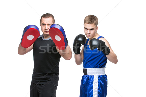 Young boxer working out with coach Stock photo © svetography